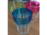Three large glass tumblers