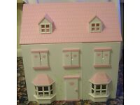 Dolls House with funiture and a family off dolls.