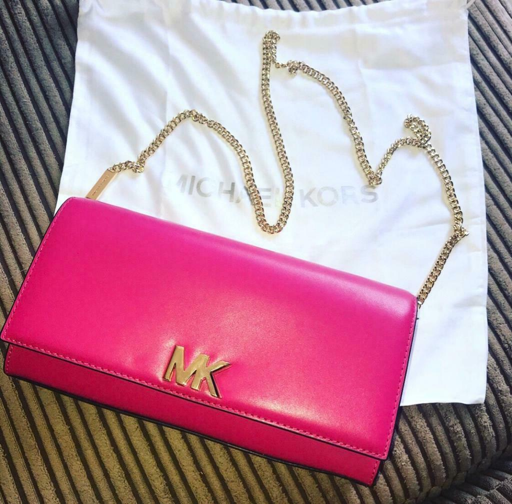 186fb38e1cbe Brand new authentic Michael Kors Ultra Pink Mott Leather Chain Wallet