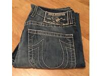 Brand new authentic men's waist 33 True Religion jeans. Mickey Big T style