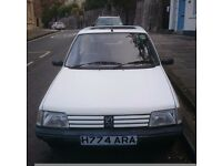 Peugeot 205, low insurance, 6 months MOT, full service history. £175.