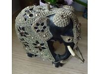 Antique Indian elephant with metal decoration. unusual thing.