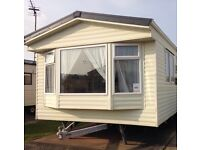 Static caravan with decking for hire/rent on golden gate towyn north wales