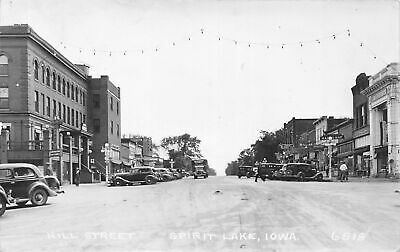 F99/ Spirit Lake Iowa RPPC Postcard 1936 Hill Street Stores Bank Truck