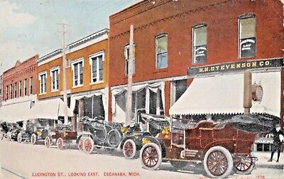 ESCANABA MICHIGAN~LUDINGTON STREET LOOKING EAST-STOREFRONTS & CARS POSTCARD 1914