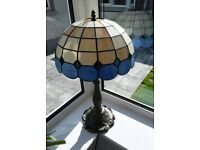 "Tiffany style lamp 24""high."