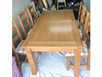 immaculate extendable wooden table and 6 chairs