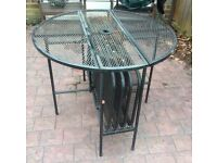 Black metal circular drop leaf table with 4 folding chairs