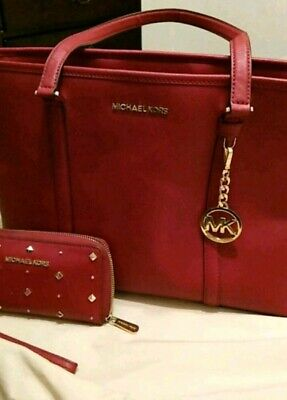 Authentic Michael Kors Tote  red w/ gold  matching purse and wallet set
