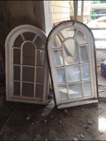 Two arched windows ready for collection