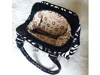 Textured zebra print handbag