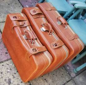 Brown genuine leather suitcases
