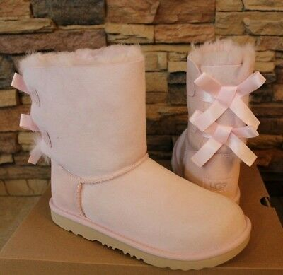 Bailey Bow Ugg (NIB UGG Women's Water Resistant BAILEY BOW Classic Short Boots SEASHELL PINK 7)