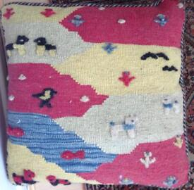 Double sided nomadic cushion