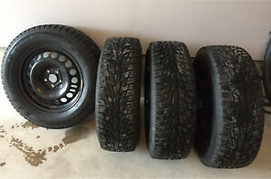 4 Winter Tires on steel rims 215/65R16 98T