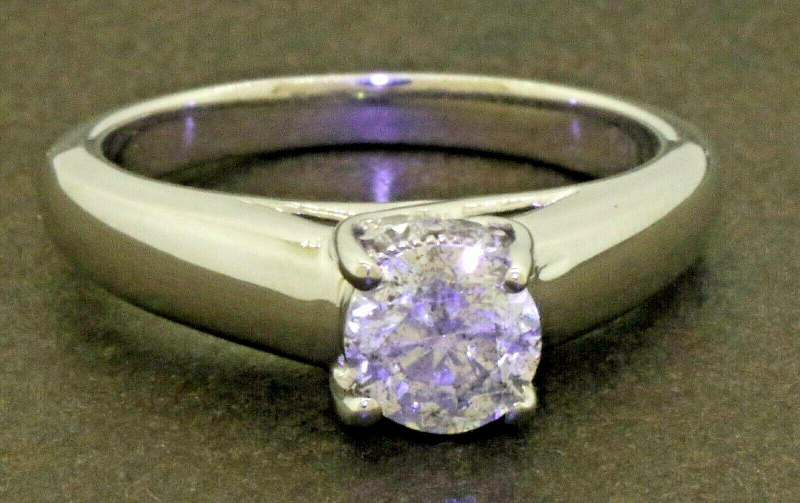 IGI certified 14K WG .97CT diamond wedding/engagement ring w/ .87CT ctr. size 7
