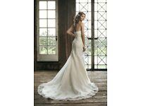 Ivory lace wedding dress size 14/16 chapel train .