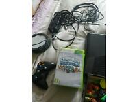 Xbox 360 with games and sky landers