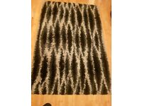 A black and grey Large rug for sale
