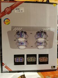 Brand new ceiling light with colour changing led's and remote control. Weymouth Dorset