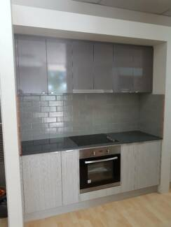 New Kitchen Bench and Over Head Cabinets with appliances
