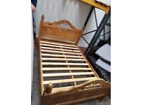 Mexican pine bed frame, with rod iron inlay in head board and foot board like new.