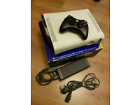 Xbox 360 with controller for sale.