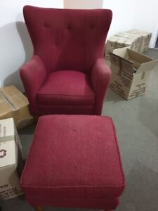 Red armchair with foot rest