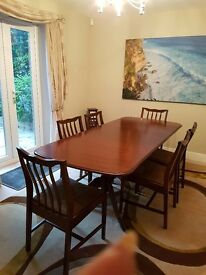 Stag Minstrel dining table and 6 chairs for sale