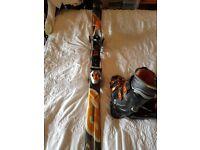 Set of Ski Boots and Skis