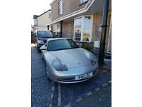 Only 36000 miles .Beautiful porsche 911 carrera in silver with black leather