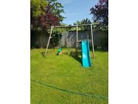 Children's outdoor swing and slide for sale.