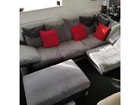 Corner sofa with foot stall
