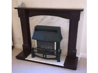 Gas fire with marble surround and wooden hearth