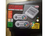 Super Nintendo SNES Classic Mini (in hand)