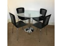Round Glass table (100cm diameter) and 4 black wooden chairs