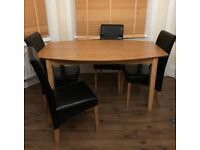 Wooden Dining Table And 4 Leather Chairs