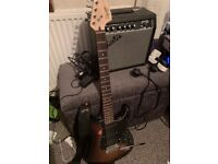 Squier Stratocaster electric guitar with amp, leads and gig bag
