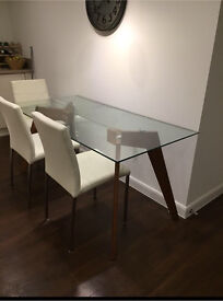 Modern glass table with solid oak legs