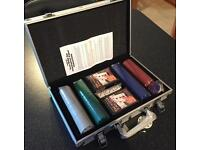 Brand new poker set in metal carry case.