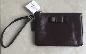 Coach Bow clutch / wristlet purse. Maroon. New With Tags - $20.
