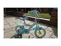 George Pig bike with stabilisers