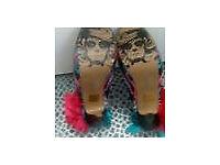 Iron fist stiletto skull shoes