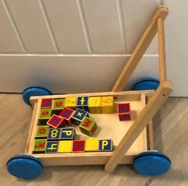 Wooden push walker with alphabet blocks