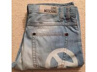 Brand new men's Moschino designer jeans. Sandblasted effect. Straight leg. Waist 34. Leg 32