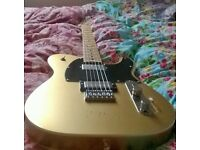 Gold fender telecaster. Double bound, double humbucker