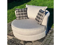 A New Designer Biscuit Fabric Swivelling Arm Chair.