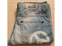 Brand new men's Moschino designer jeans. Sandblasted effect. Tequila Bum Bum fit. Waist 34. Leg 32