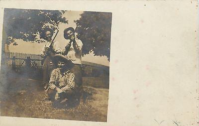 Real Photo Postcard~Two Men Aim Guns Skyward~One Sits Like Huck Finn~c1920 pc