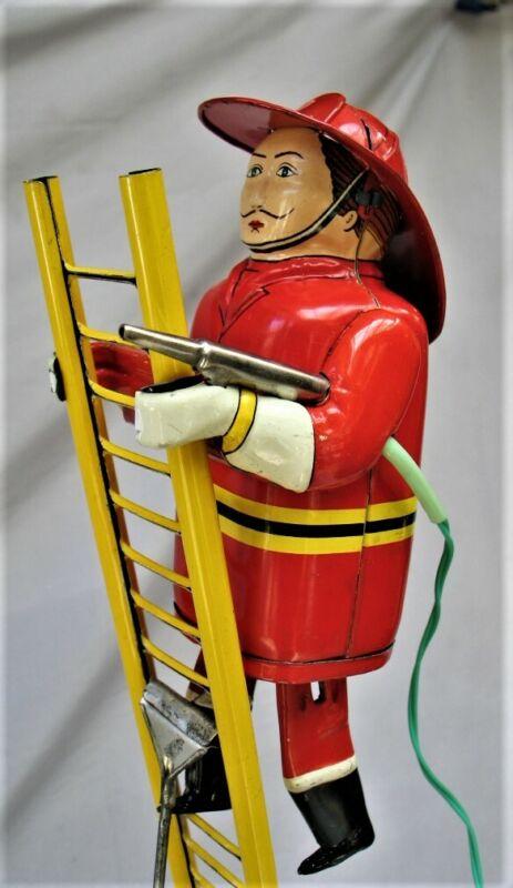 Vintage Tin Battery Operated Fireman Climbing Ladder with Original Box - Japan